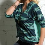 Image of women's three quarter sleeve teal henley blouse from Cruel Girl
